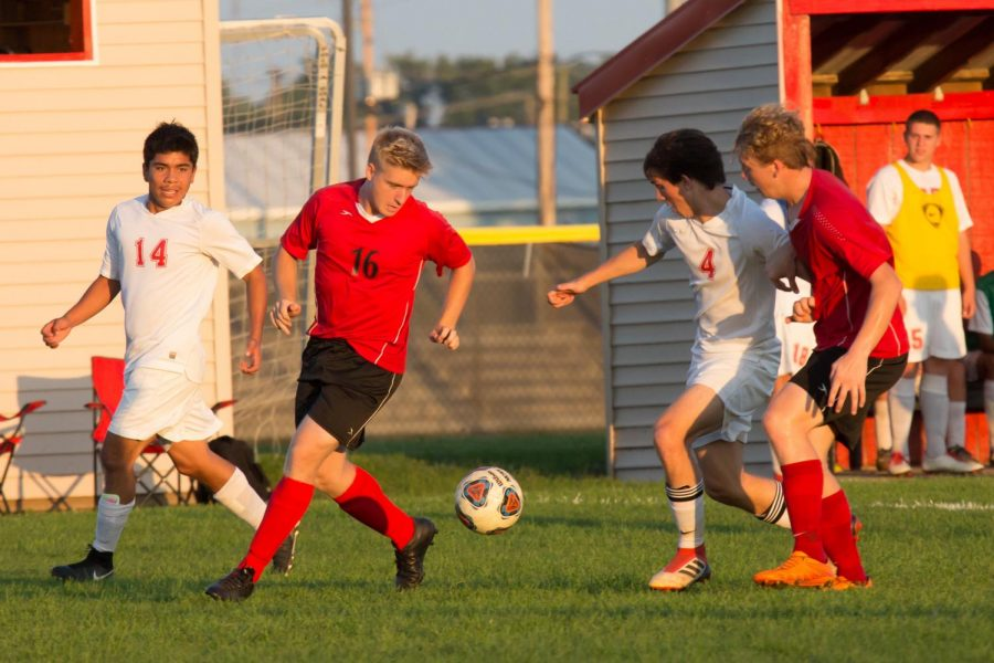 Senior Austin Arbaugh kicks the ball in a match against the Goshen Redhawks on Tuesday, Aug. 23.