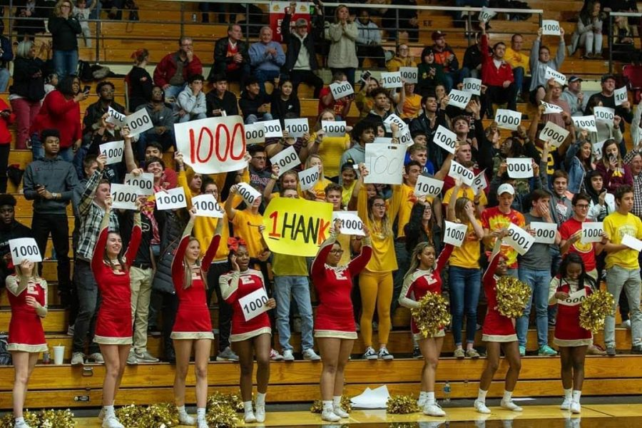 Students at Elkhart Memorial High School hold up signs congratulating Hank Smith on scoring 1,000 career points.