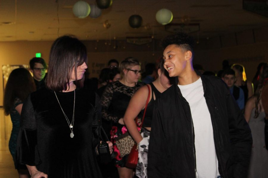 Assistant Principal Kelly Blair joins the fun and dances alongside Haylee Hinkley. The Winter Dance is a tradition that gives students and staff alike a chance to have fun outside of the walls of the classroom.
