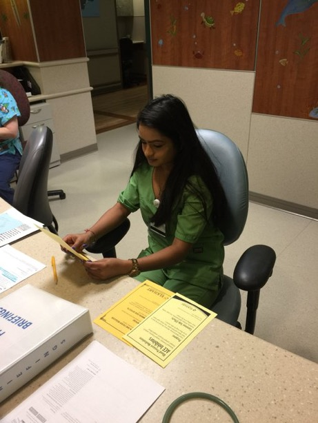 Senior Ritu Patel works hard at her internship. She loves helping out people at Elkhart General Hospital and is seeking a bright future.