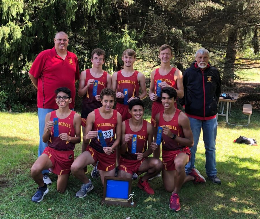 The Boys varsity Cross Country team celebrating after winning the Northern Lakes Conference championship at Ox bow park on Saturday, Sept. 29, 2018.