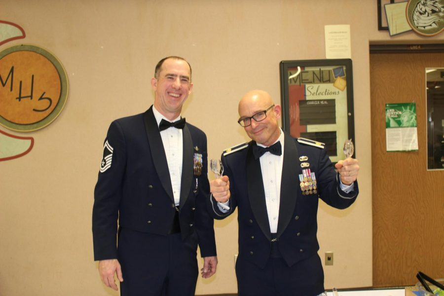 Senior Master Sergeant Rutledge and Major Dorman hang out during the Military Ball in the EMHS cafeteria on Saturday, Jan. 12. The ball is a JROTC tradition that gives cadets an opportunity to celebrate their accomplishments as well as learn how to plan a formal event.