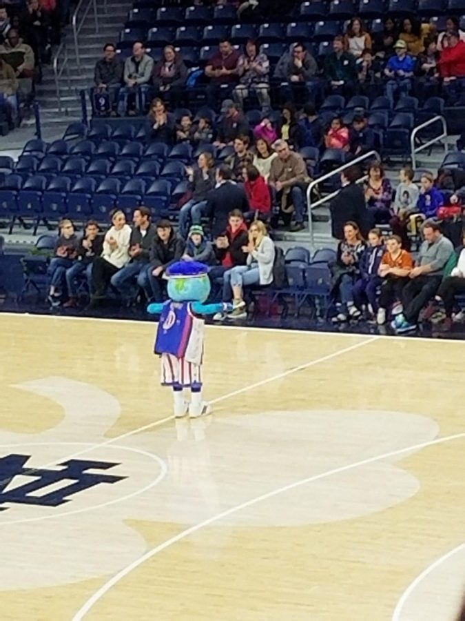 Globie, the mascot for the Harlem Globe Trotters, dances for the crowd at the Notre Dame Joyce Center on Thursday, Jan. 27.