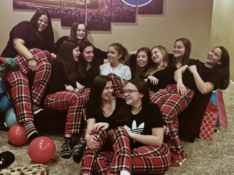 (Top to bottom) Freshmen Paityn Sheldon and Mattie Kauffman; sophomore Felisha Campanello, seniors Jeanne Elliott and Lynsey White; sophomore Gabby Scott, juniors Morgan Dyer and Sarah Brummet; freshman Natalie Wolschlager and Lauren Elliott, and sophomore Trinity Fine laugh together at their Christmas party on Saturday, Dec. 8. 2018. Simple Pursuit is an all girls group that has been meeting since 2017.