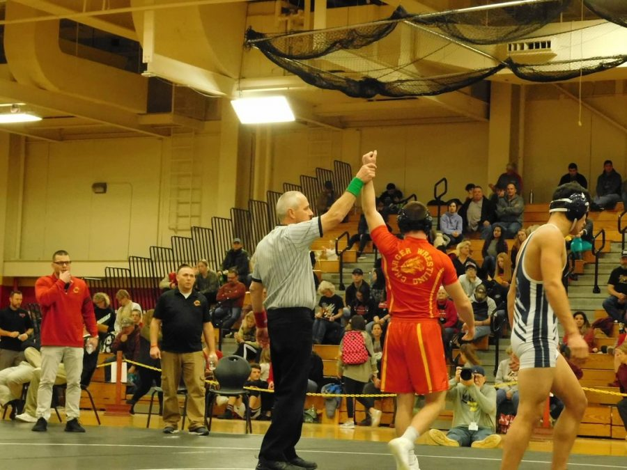Sophomore+Clayton+Lundy+raises+his+arm+in+victory+on+Jan.+26+in+the+Elkhart+Memorial+Fieldhouse.+He+was+elected+Sectional+champion%2C+of+the+160+pound+weight+class.