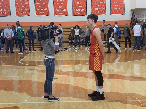 Junior Brackton Miller being interviewed after having a big night. Miller finished with 18 points.