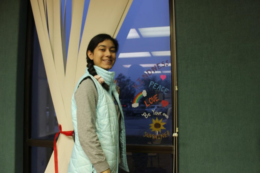 Senior Sharon Camacho finishes her window drawing in Eileen Misener's classroom on Wednesday Feb. 5. The students hoped the messages and drawings would inspire cheerful attitudes during this deary time of year.