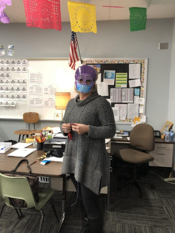 """Spanish two and three teacher Ms. Scalise leads by example being the first to cut out and wear her mask during """"Wooly Week"""" on Feb. 11."""