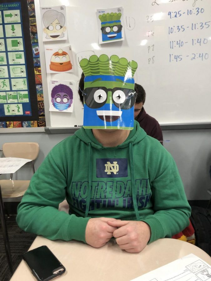 """Junior Ty Miller shows off his favorite Señor Wooly character """"Billy la Bufanda"""" during the annual """"Wooly Week,"""" on Feb. 11."""