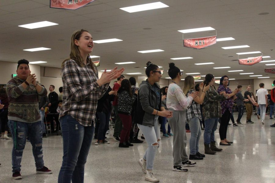 Students dance to the song,