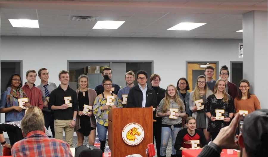 Students celebrate earning their academic letter at a banquet on Wednesday, Feb. 13. The first ever academic letters were awarded to 26 Elkhart Memorial students.