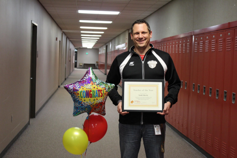 Geography teacher Todd Sheely poses with his award shortly  after being named the 2019 Teacher of the Year at Elkhart Memorial on Friday, March 15. On this morning, Sheely was presented the award in front of his first period class.