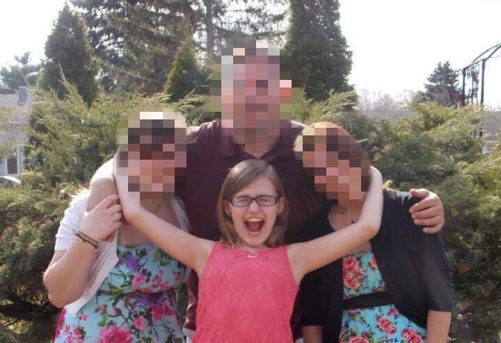 Abigail Gratzol posing for family photo on Easter Sunday, April 20, 2014.