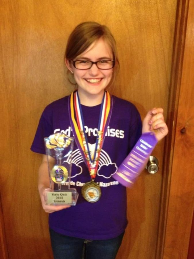 Abigail Gratzol displaying awards won State Bible Quiz in which she had two perfect rounds on May 10, 2014.