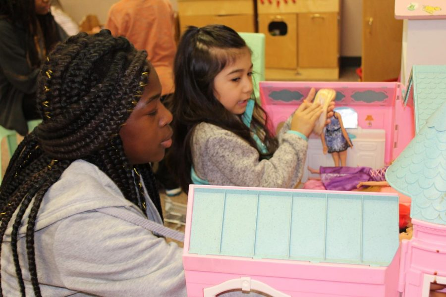 Sophomore Jamiya Gladden and her preschool buddy play house with Barbie dolls on Wednesday, April 17. The EMHS Preschool ran by teacher Kara Sears and Advanced Child Development is a way for high schoolers to gain first hand experience with children.