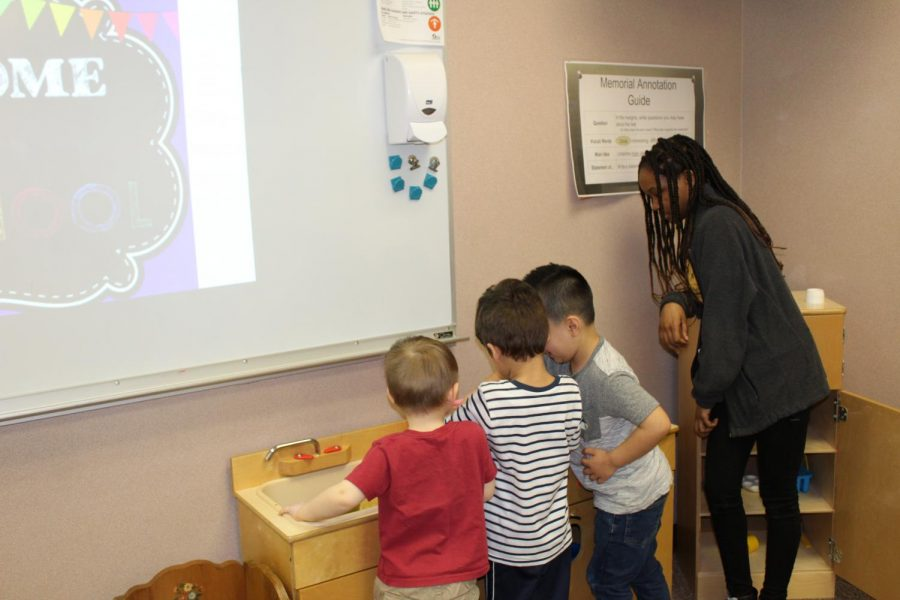 Freshman Nykeria Harper watches over her preschool buddies as they play chef together Wednesday, April 17. The EMHS Preschool ran by teacher Kara Sears and Advanced Child Development is a way for high schoolers to gain first hand experience with children.