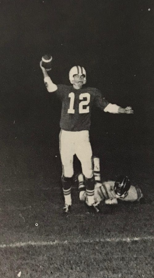 Former Charger quarterback Rich Boling throwing the ball downfield against the Riley Wildcats in the 1973-1974 season.