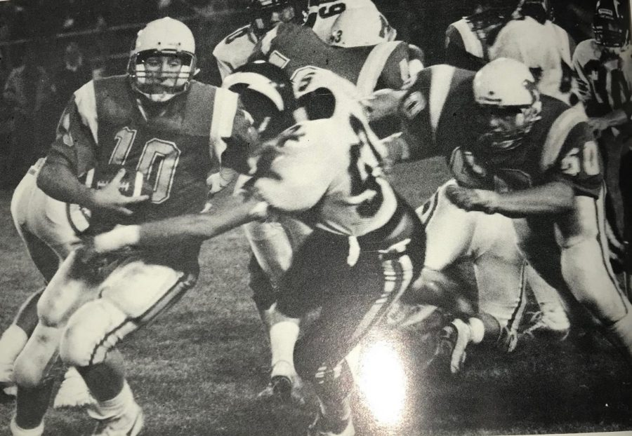 Former Charger quarterback Ross Hales breaks a Central tackle.