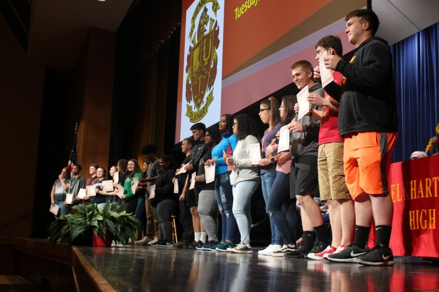 Juniors line up on stage in the auditorium to receive their academic awards on Tuesday, April 23.