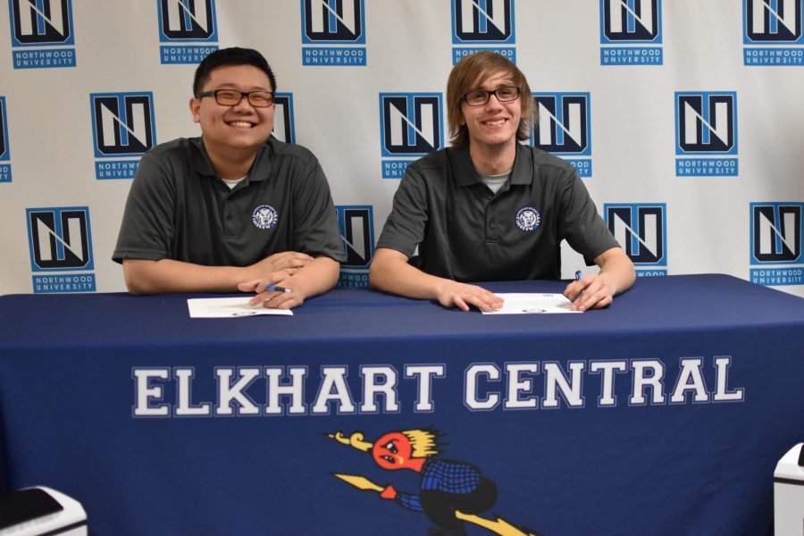 Seniors Kevin Wu and Robert Izbicki (left to right) both sign their letter of commitment  on Wednesday, May 1.  They both plan to attend Northwood University and play eSports.
