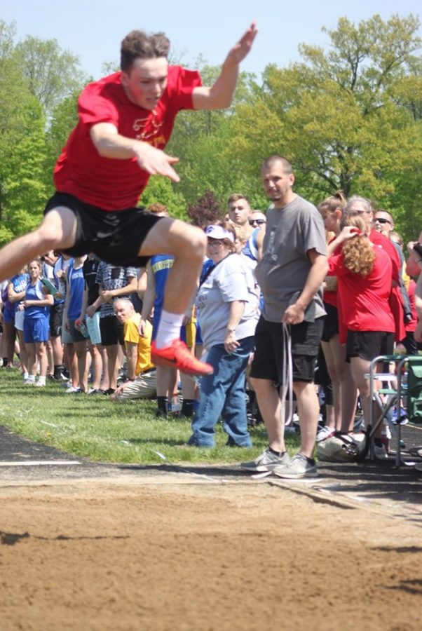 Senior Logan Mullins goes airborn on his final jump of the competition. Mullins had the winning jump, soaring 19 feet and 3.5 inches.