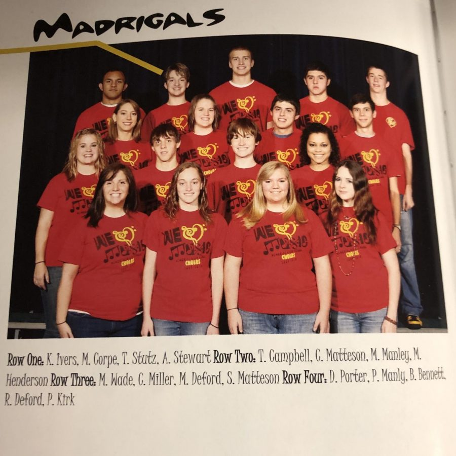 The 2010 Madrigals pose for their yearbook photo. ISS paraprofessional and assistant theater director, Matthew Manley, is pictured.