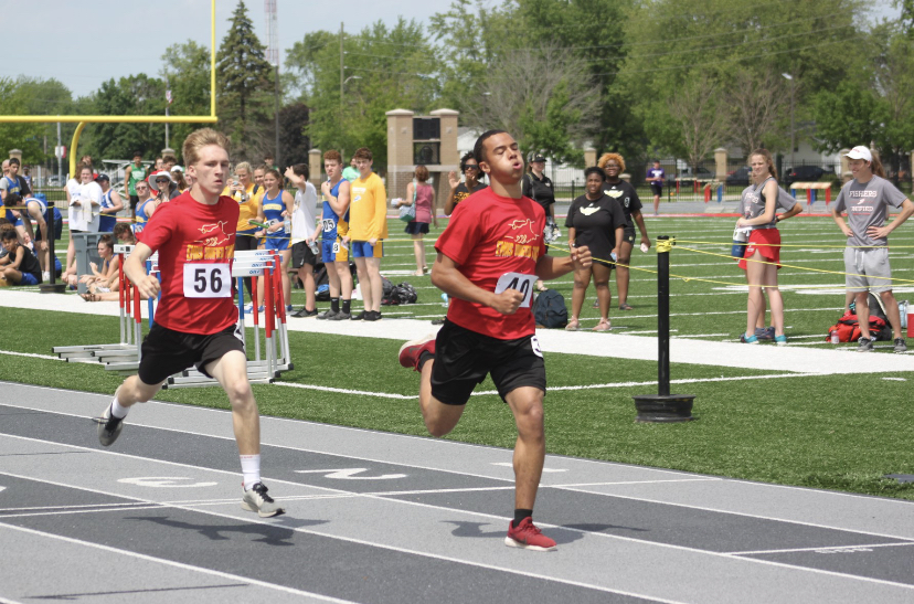 Senior John Rehmels finishes second place right behind junior teammate Isiah Johnson. Rehmels and Johnson earned 18 points in their heat of the 400 meter race.