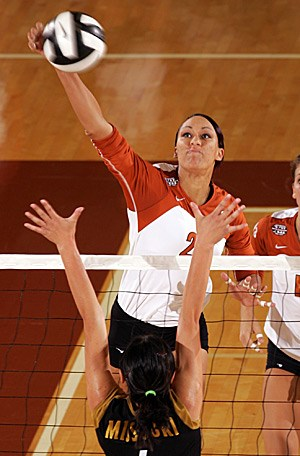 Miss Armstrong spikes the ball over a Missouri defender. Armstrong played for the Longhorns from 2003-2008.