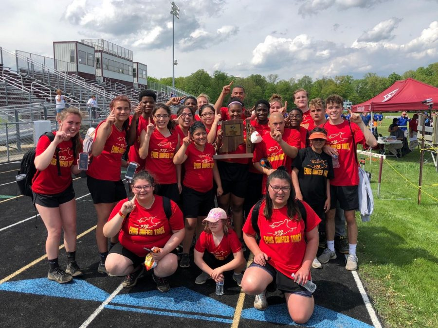 The Elkhart Memorial Unified Track team celebrates a sectional championship on Saturday, May 18, 2019 at Central Noble.