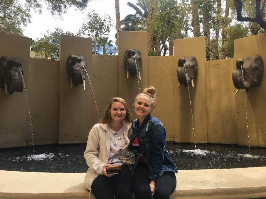 Senior Madison Goss (left) and Sloan Goss-Marbaugh (right) smile in front of a water fountain in Las Vegas, Nevada on Sunday, April 13. Goss-Marbaugh lost her battle with cancer on May 27.
