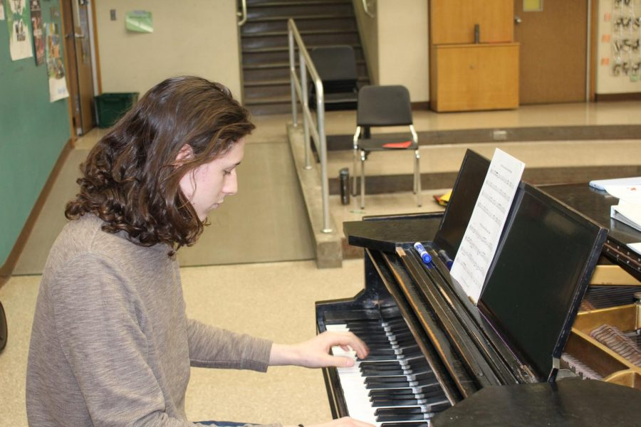 Junior Tyler Rouch plays the piano on Friday, March 8 to demonstrate one of his many instrumental talents.