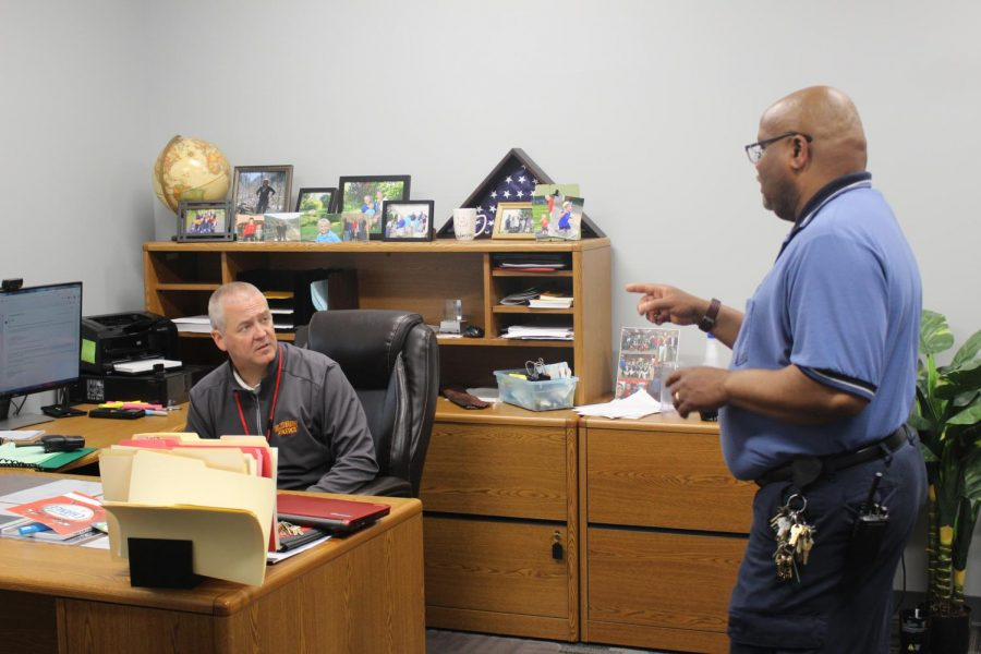 Head custodian, Willie Coleman and Mr. Anderson talk about mowing the property on Tuesday, May 7. Coleman is just one person in the school that Mr. Anderson must keep in constant contact with in order to make sure that Elkhart Memorial is running successfully and smoothly.
