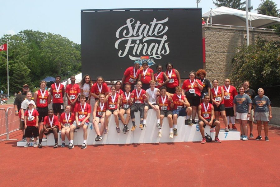 The Chargers pose for a picture on the podium after placing third at the state meet in Bloomington, Indiana.