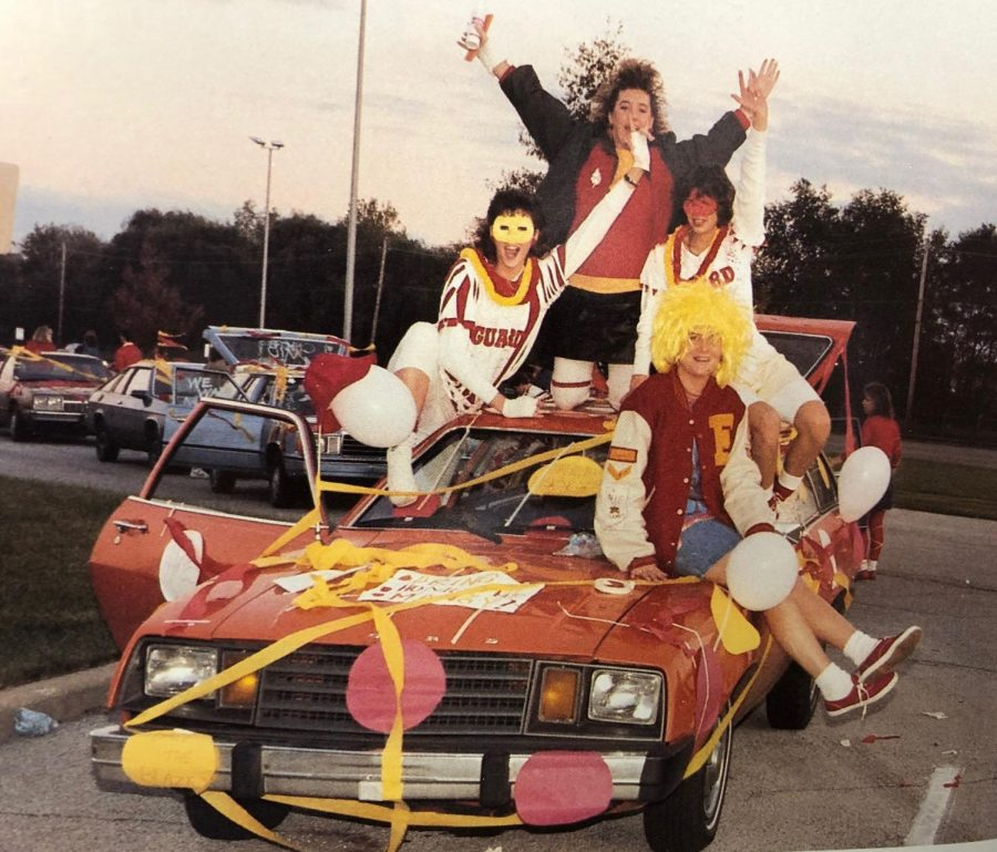 Atop their decorated car, Tania Hayes, Gretchen Bohs and Lisa Holland get ready to roll to the Mangy game. About 60 cars were in the caravan. After attempting to resurrect the caravan tradition for the final Mangy game, a lack of student participation led to the cancellation of the event.