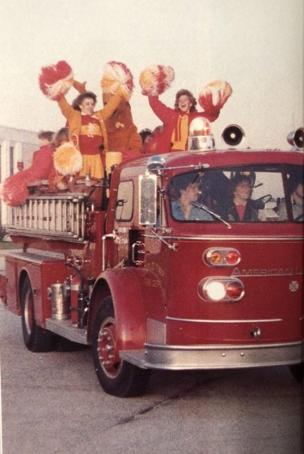 Cheerleaders ride on top of a borrowed fire truck, leading the caravan on its way to the Memorial-Central football game in the 1984 Memorial yearbook. After attempting to resurrect the caravan tradition for the final Mangy game, a lack of student participation led to the cancellation of the event.