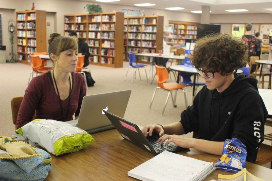 Junior Dominique Kunz and English teacher, Eileen Corson work together in the library after school on Thursday, Sept. 12. Elkhart Memorial offers a unique tutoring program where teachers are available after school in the library on Tuesdays, Wednesdays, and Thursdays until 4:00 p.m.