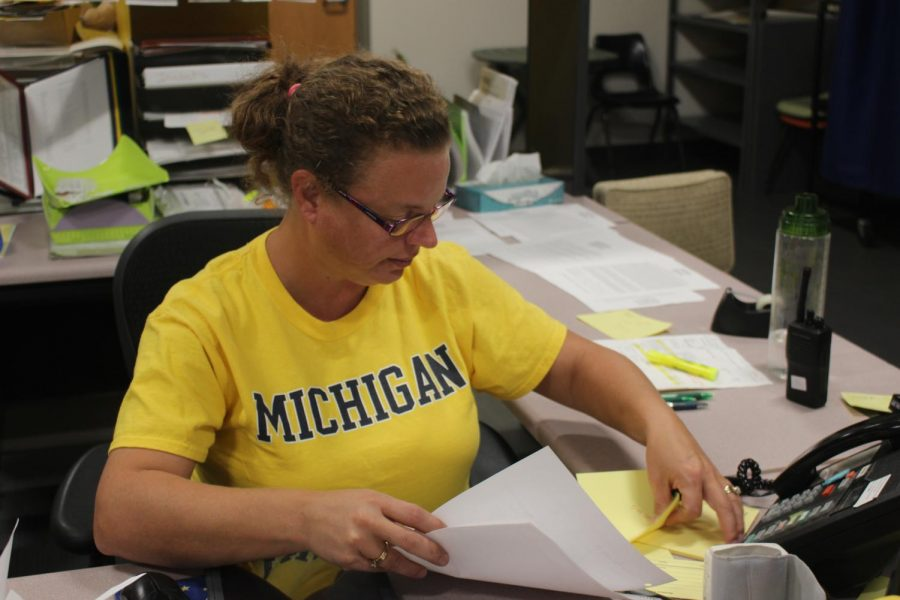 Nurse Jennifer Geers organizes paperwork in her office on Friday, Sept. 27. Geers answers the question,