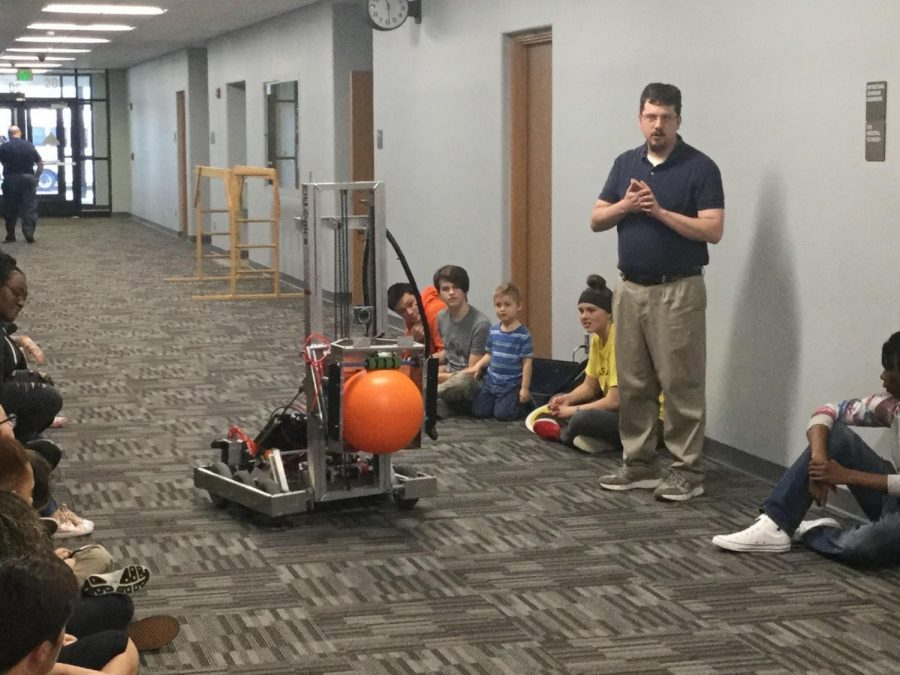 Robotics Coach and EMHS Technology and Engineering teacher, Nick Seidl, shares a robot built by the Robotics Team with the preschoolers enrolled in Mrs. Sear's Advanced Child Development Program on Thursday, May 9 at Elkhart Memorial High School.