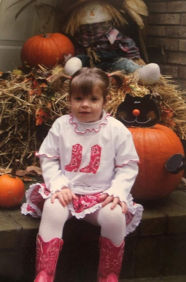 """Junior Gabriella Scott at two years old wears a cowgirl costume. """"My mom bought the costume at a children's store in Tennessee while on vacation that year so that I could match my two older cousins for Halloween."""""""