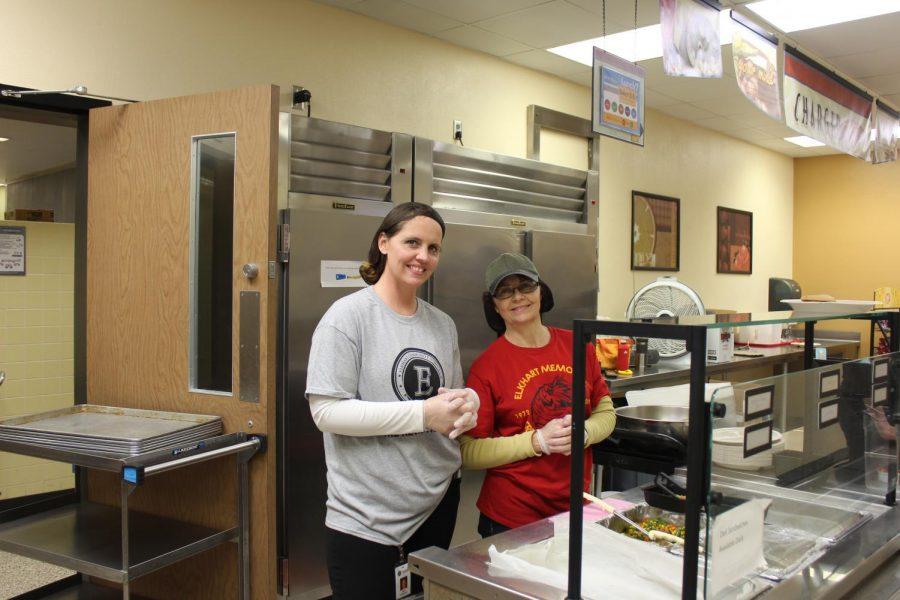 Math teacher Julie Tyrakowski and Brenda Goethals serve lunch on Friday, Oct. 18 for National School Lunch week.