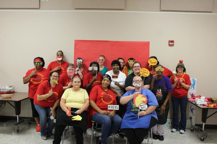 The lunch staff poses with props for a group photo for National Lunch Week on Friday. Oct. 18.
