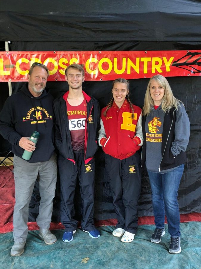 Senior Neil Terrell and sophomore Rachel Terrell smile with their parents on Saturday, Oct. 19. The siblings found out they were moving on to Semi-state for cross country.