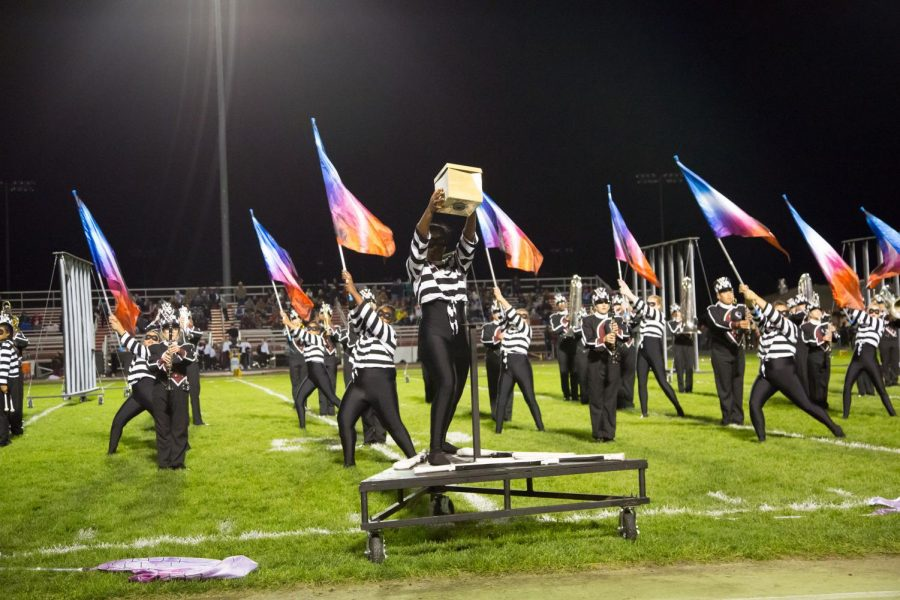 Color Guard performs with the band on Fri., Oct. 4 on the football field during halftime. The name of their performance is