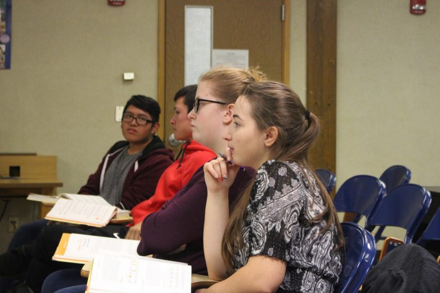 Lacy Whitmer follows along on the lecture during her AP Music Theory class on Wednesday,Oct. 30. There are only four other students along with Whitmer that take this challenging course.
