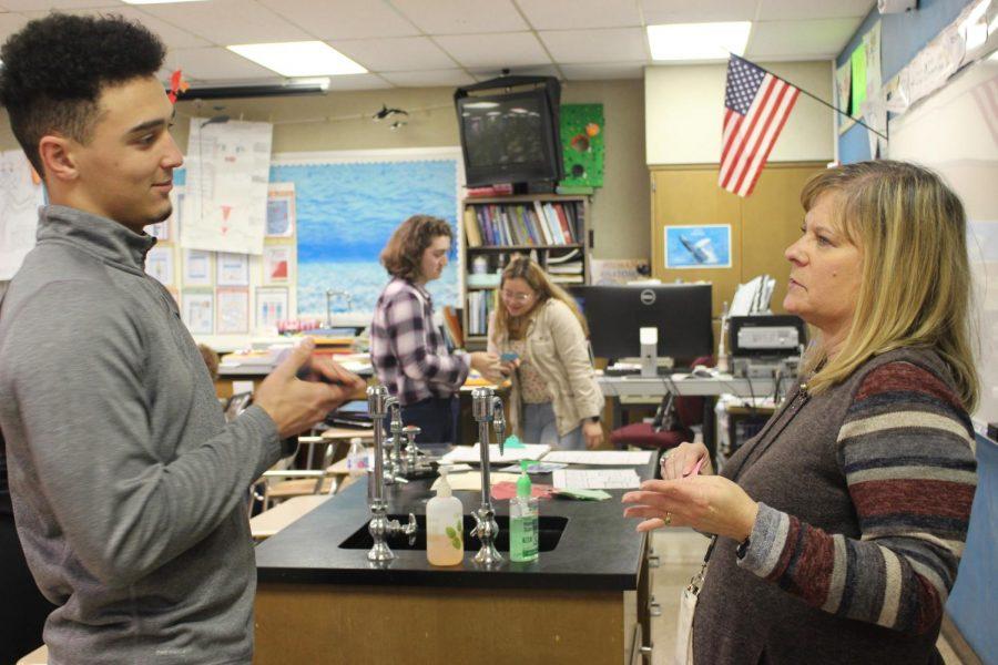 Senior Kamden Goering and teacher Heidi Krusenklaus discuss their test based questions on Monday, Nov. 4.