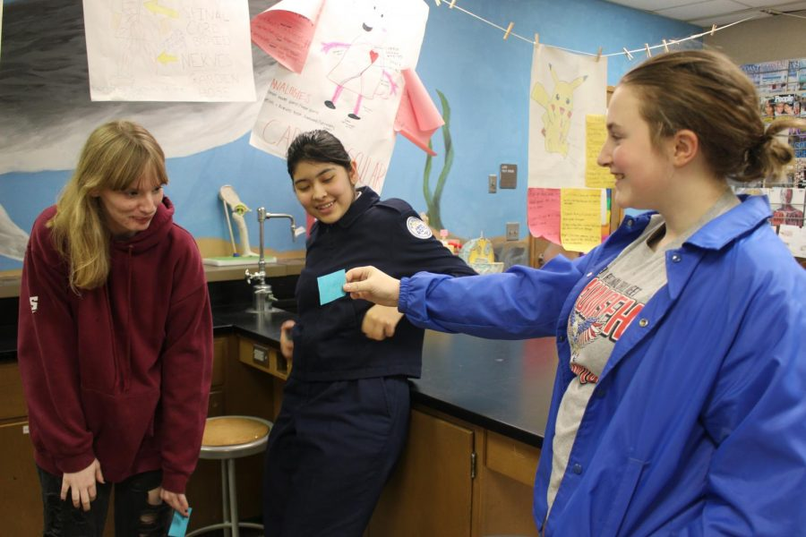 Allison Bates (12), Ariana Correa (10), and Valerie Cole (11)  talk about their test based questions on Monday, Nov. 4.
