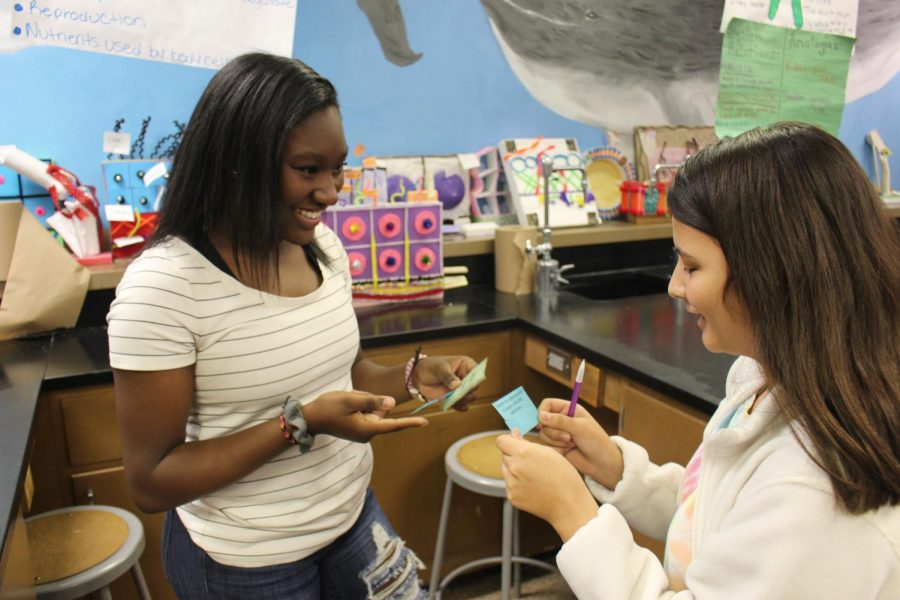 Sophomores Domunique Richardson- Bates and Abigail Orta quiz each other with test based questions on Monday, Nov. 4.