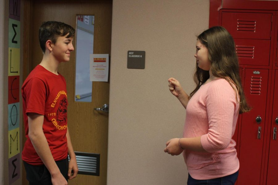 Freshmen Owen Lewis and Natalie Edmisten practice their dialogue moments before recording their assignment on Monday, Nov. 25.