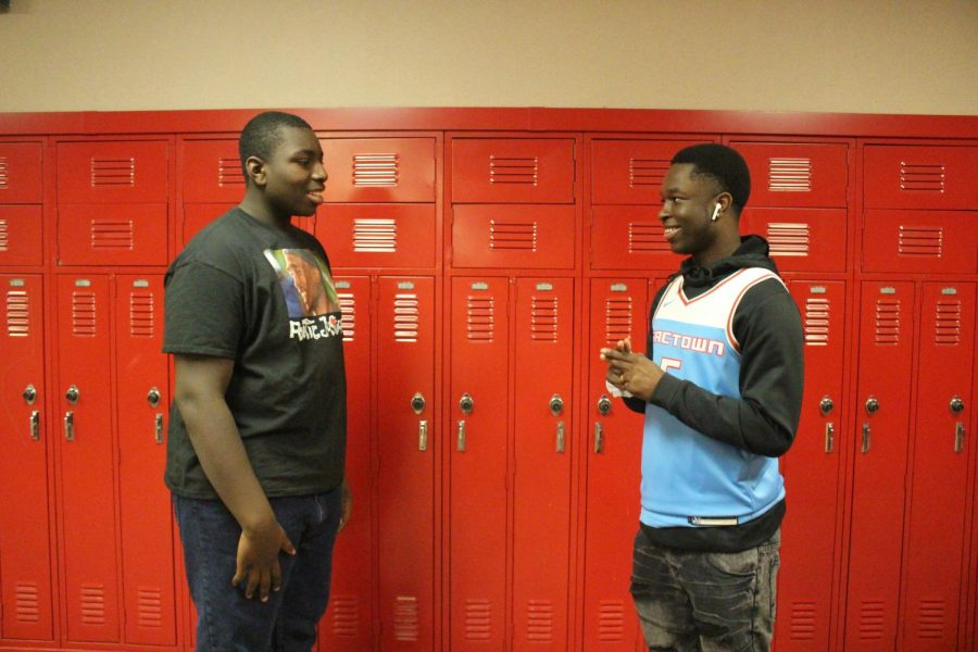 Freshman Rae'Kwon Lemons and Junior Derrick Woods introduce each other in sign language on Monday, Nov. 25.