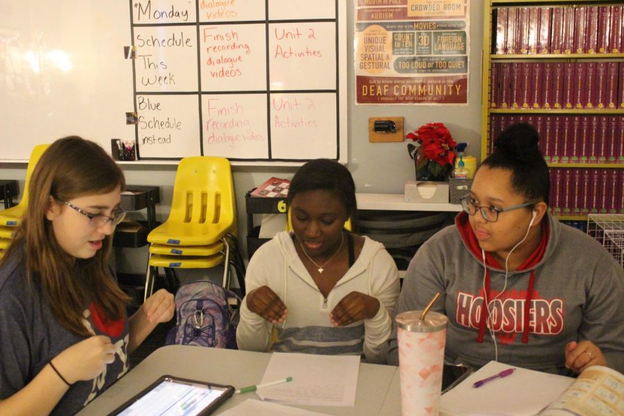 Freshman Alexis King, Sophomore Domunique Richardson- Bates, and Junior Olivia Cooper go over vocabulary words before recording their assignment on Monday, Nov. 25.